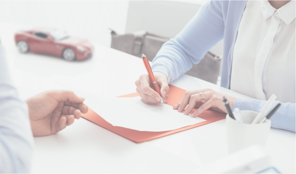 insurance attorney signing paperwork with a client